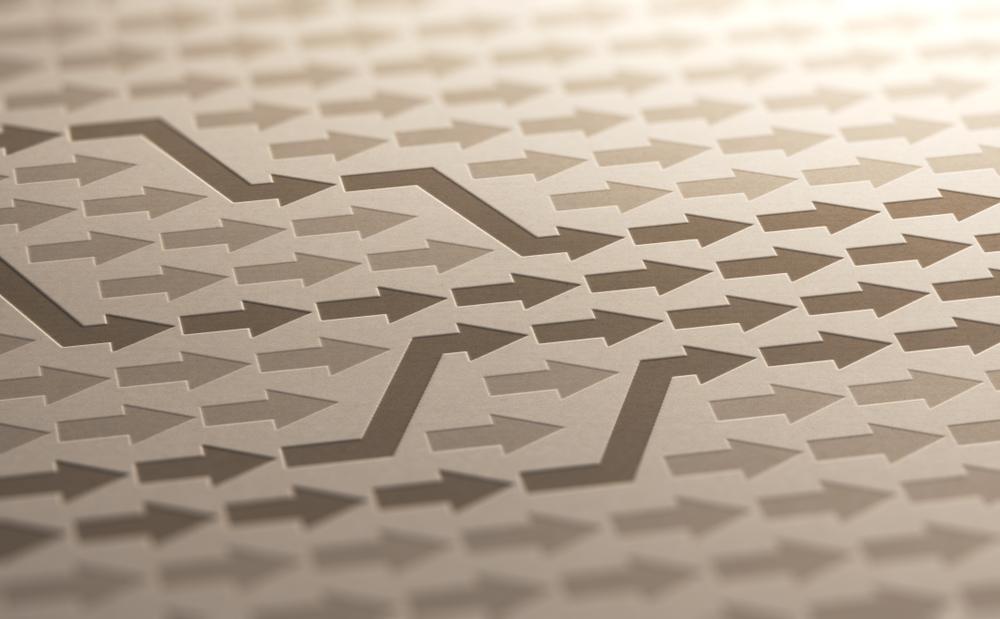 Grafica: frecce convergenti © Olivier Le Moal/Shutterstock