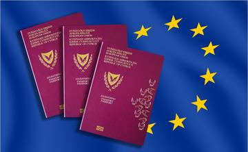 Three Cypriot passports against the backdrop of the EU flag - © AlexiaD/Shutterstock