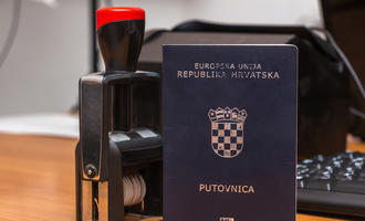 Croatian passport, (photo © Ivan Semenovych/Shutterstock)