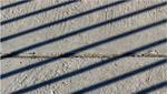 Immagine che rappresenta linee d'ombra sul cemento - © Serhii Ivashchuk/Shutterstock