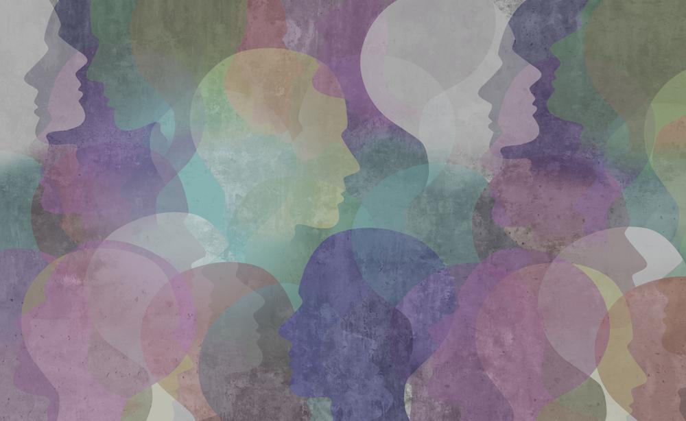 Sfondo con silhouette di teste colorate a simboleggiare la diversità © Lightspring/Shutterstock