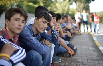 Afghan and Pakistani refugees waiting for daily work in Istanbul, Turkey, 12 July 2016 - Orlok/Shutterstock