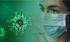 Rappresentazione del virus responsabile del COVID19 insieme ad una persona che indossa la mascherina protettiva