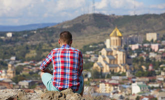 Pensive man is looking on Tbilisi - Georgia © Jaromir Chalabala/Shutterstock