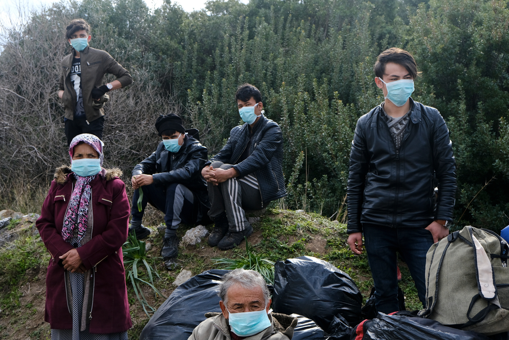 Refugees and migrants wearing masks