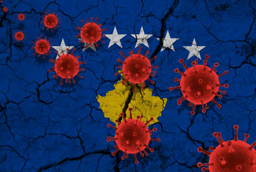 Red virus cells against the background of a cracked Kosovo flag