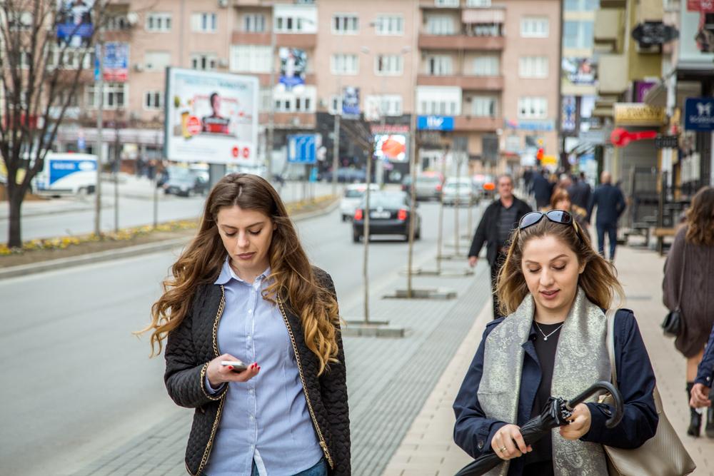Two girls in Pristina (© JulianBuijzen/Shutterstock)