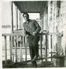 Paul Antaramian standing along the porch rails of the American's house in Yerevan