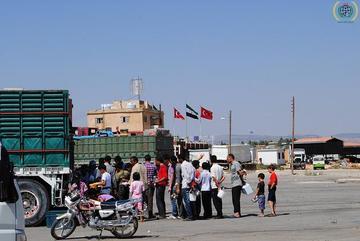 Distribuzione di aiuti umanitari al confine turco-siriano, foto di IHH Relief Foundation - Flickr.com