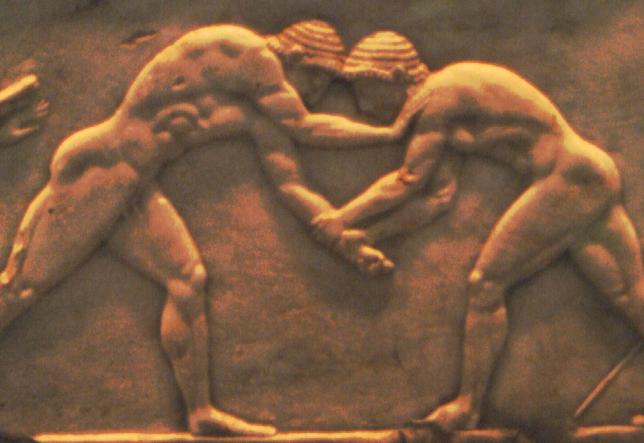 Rilievo su base di statua con due antichi lottatori. VI sec. a.C. Atene