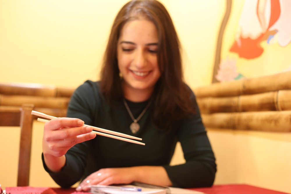 "Astghik shows how to use chopsticks. It was not an easy skill to learn, but now she is ""a professional"" - Armine Avetisyan"