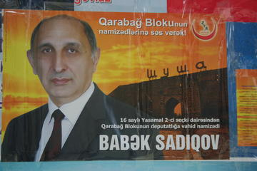 "Electoral poster of one of the candidates of the ""Karabakh"" bloc (photo: A. Geybullayeva)"