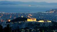 La sera scende su Atene, vista dal monte Licabetto. In primo piano l'Acropoli con il Partenone (MarcelGermain /Flickr)