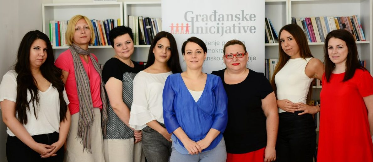 Maja Stojanovic, in the centre in blue, with her staff