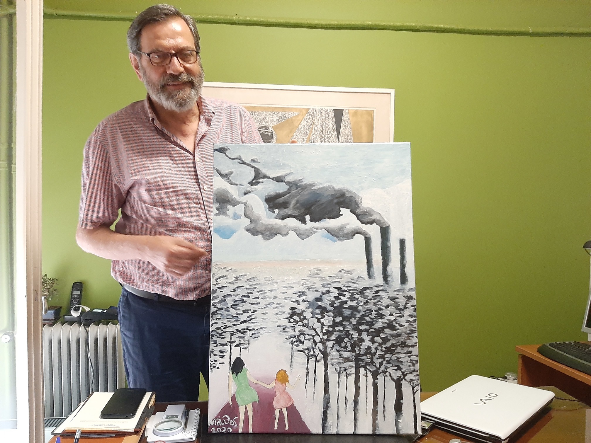 Cardiologist Matthaios Dramitinos, hobby painter, shows his latest work depicting pollution in his city