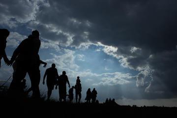 Persone che migrano (JK21/Shutterstock)